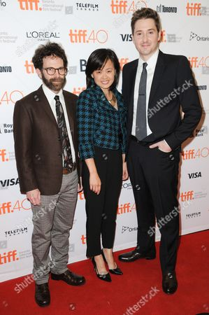"Director Charlie Kaufman, from left, Producer Rosa Tran and Director Duke Johnson attend a premiere for ""Anomalisa"" on day 6 of the Toronto International Film Festival at the Princess of Wales theatre, in Toronto"