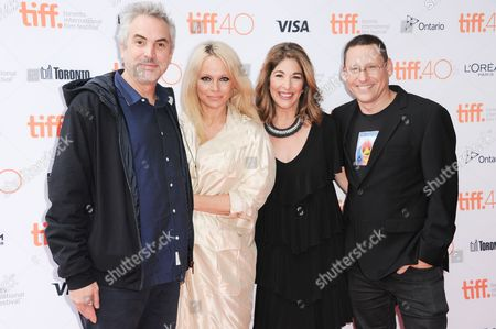 """Executive Producer Alfonso Cuaron, from left, Producer Pamela Anderson, Journalist Naomi Klein and Director Avi Lewis attend a premiere of """"This Changes Everything """" on day 4 of the Toronto International Film Festival at the the Ryerson theatre, in Toronto"""