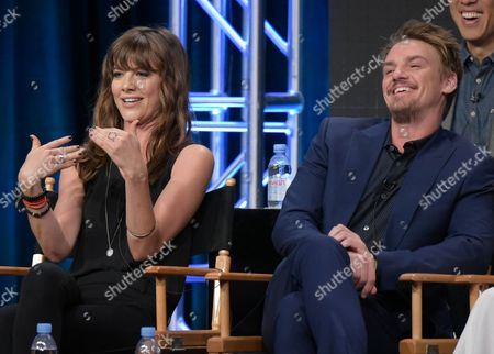 "Devin Kelley, left, and Riley Smith participate in the ""Frequency"" panel during The CW Television Critics Association summer press tour, in Beverly Hills, Calif"