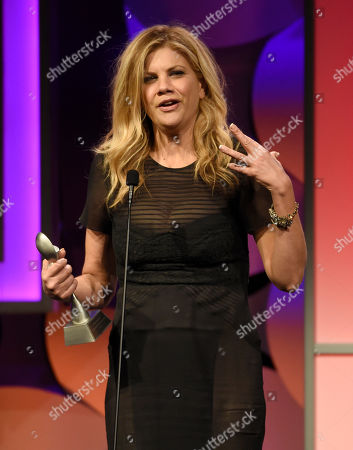 """Stock Picture of Kristen Johnston accepts the award for outstanding female in a leading role in a comedy or musical for """"The Exes"""" at the 40th Anniversary Gracies Awards at the Beverly Hilton Hotel, in Beverly Hills, Calif"""