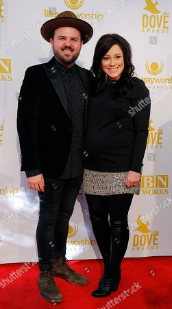 Stock Picture of Kari Jobe, right, and husband Cody Carnes attend the 46th Annual GMA Dove Awards at Lipscomb University, in Nashville