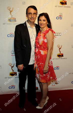 Academy Governor Frank Morrone, left, and his wife arrive at the 65th Primetime Emmys Writers Nominee Reception,, at the Leonard H. Goldenson Theatre, in North Hollywood, Calif