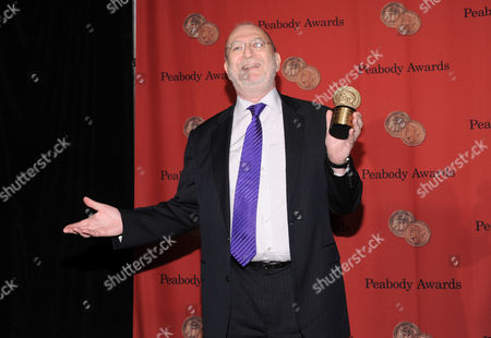 Stock Image of WNYC Radio talk show host Leonard Lopate poses with his award at the 72nd Annual George Foster Peabody Awards at the Waldorf-Astoria on in New York