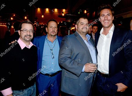 Stock Image of IMAGE DISTRIBUTED FOR IFTA - Scott Bedno, Vice President, International Sales and Distribution, from left, John Fremes, President, International Sales and Distribution, Jonathan Deckter, President & COO, and Craig Flores - President/Partner Voltage Productions, attend the Voltage Pictures Ten Year Anniversary Party at the American Film Market (AFM) held at Wokano, in Santa Monica, Calif