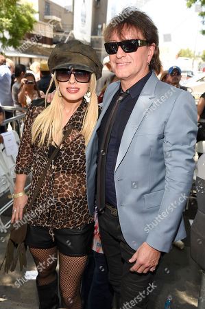 Orianthi, left, and Richie Sambora pose during a ceremony honoring Al Schmitt with a star on the Hollywood Walk of Fame, in Los Angeles