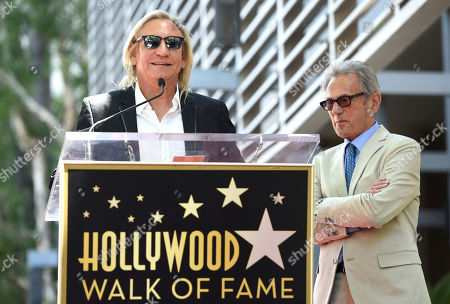 Joe Walsh, left, and Al Schmitt speak during a ceremony honoring Schmitt with a star on the Hollywood Walk of Fame on in Los Angeles