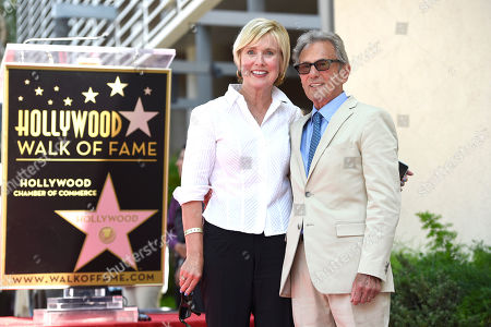 Al Schmitt, right, and wife Lisa Schmitt pose during ceremony honoring him with a star on the Hollywood Walk of Fame on in Los Angeles