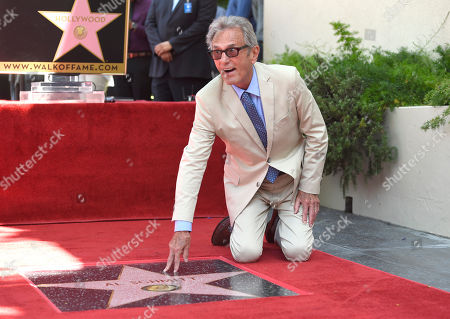 Al Schmitt poses with his star during the ceremony honoring him with a star on the Hollywood Walk of Fame on in Los Angeles