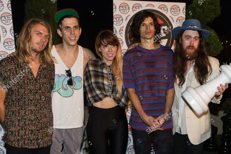 From left, Andrew Wessen, Ryan Rabin, Hannah Hooper, Christian Zucconi and Sean Gadd of Grouplove pose for a group photo at the Alt 98.7 Penthouse in the Historic Hollywood Tower on in Hollywood, California
