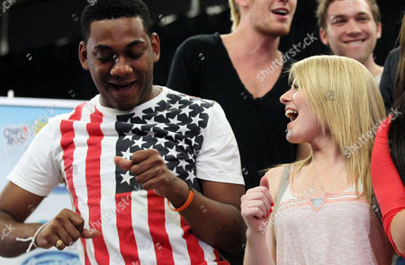 American Idol season 11 contestants Joshua Ledet, left, and Hollie Cavanagh perform at the American Idol Live! Tour press junket on in Los Angeles