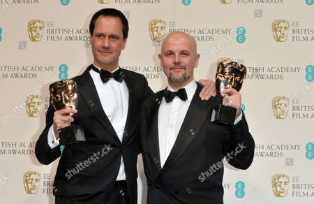 Diarmid Scrimshaw and Peter Carlton, winners of the Short Film award for 'Swimmer' backstage at the BAFTA Film Awards at the Royal Opera House, in London