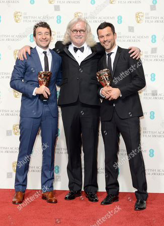 Billy Connolly (C) with winners of Outstanding Debut By A British Writer, Director or Producer Bart Layton and Dimitri Doganis backstage at the BAFTA Film Awards at the Royal Opera House, in London