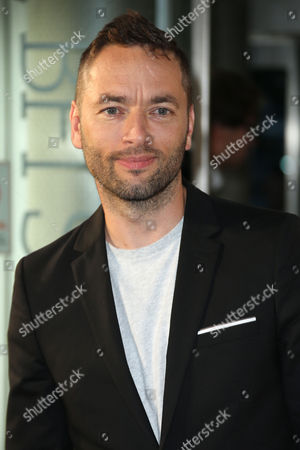 Director Sean Ellis poses for photographers upon arrival at the premiere of the film 'Anthropoid' in London