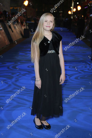 Actress Faith Wood-Blagrove poses for photographers upon arrival at the premiere of the film 'Fantastic Beasts And Where To Find Them' in London