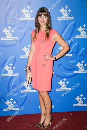 Ellie Crisell poses for photographers upon arrival at the National Lottery Stars 2015 event in London