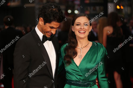 Actors Raza Jaffrey, left, and Lara Pulver poses for photographers upon arrival at the Olivier Awards in London