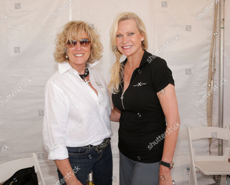 Stock Picture of Grgich Hills' Melanie Lewis and Celebrity Cruises' regional marketing manager, Cynthia Rose attend the Celebrity Cruises Great Wine Festival to Benefit LegalAid of Orange County at Hanger 244, in Irvine, Calif