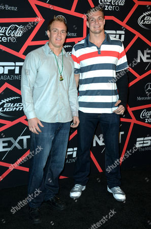 """Denver Broncos fullback Chris Gronkowski, left, and New England Patriots tight end Rob Gronkowski arrive at ESPN The Magazine's """"Next"""" Event on in New Orleans"""