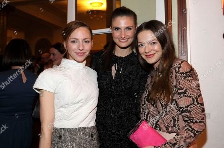Stock Photo of Katharina Schuttler, Felicitas Rombold and Hannah Herzsprung attend The Hollywood Reporter party held at Borchardt's Restaurant to celebrate the 2014 Berlin International Film Festival with Studio Babelsberg and Audi,, in Berlin
