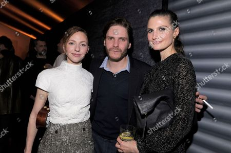 Katharina Schuttler, Daniel Bruhl and Felicitas Rombold attend The Hollywood Reporter party held at Borchardt's Restaurant to celebrate the 2014 Berlin International Film Festival with Studio Babelsberg and Audi,, in Berlin