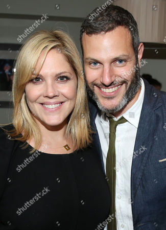 Mary McCormack, left, and Michael Morris pose for a photo as Justin Theroux and Dan Peres celebrate the August issue of DETAILS at The Sunset Tower Hotel on in West Hollywood, Calif