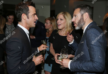 Justin Theroux, left, and Mary McCormack, center, and Michael Morris are seen as Justin Theroux and Dan Peres celebrate the August issue of DETAILS at The Sunset Tower Hotel on in West Hollywood, Calif