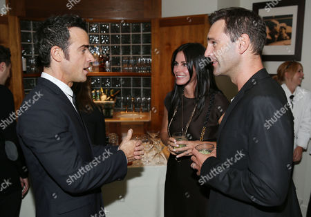 Justin Theroux, left, Courteney Cox, center, Johnny McDaid are seen as Justin Theroux and Dan Peres celebrate the August issue of DETAILS at The Sunset Tower Hotel on in West Hollywood, Calif