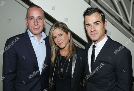 Justin Theroux, right, Jennifer Aniston, center, and Dan Peres pose for a photo as Justin Theroux and Dan Peres celebrate the August issue of DETAILS at The Sunset Tower Hotel on in West Hollywood, Calif