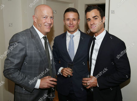 Justin Theroux, right, Bryan Lourd, left, and Joe Machota pose for a photo as Justin Theroux and Dan Peres celebrate the August issue of DETAILS at The Sunset Tower Hotel on in West Hollywood, Calif
