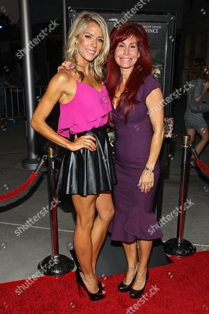 "From left, actress Suzanne Quast and producer Suzanne DeLaurentiis arrive at the premiere of ""Dark Tourist"" at the ArcLight Cinemas on in Los Angeles"