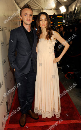 "Tom Felton, left, a cast member in ""In Secret,"" poses with girlfriend Jade Gordon at the premiere of the film, in Los Angeles"
