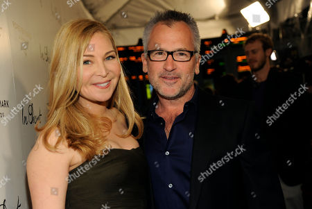 "Actress Jennifer Westfeldt, left, poses with Charlie Stratton, writer/director of ""In Secret,"" at the premiere of the film, in Los Angeles"
