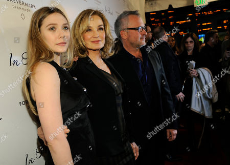 "Elizabeth Olsen, left, and Jessica Lange, cast members in ""In Secret,"" pose with the film's writer/director Charlie Stratton at the premiere of the film, in Los Angeles"