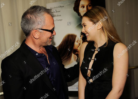 "Charlie Stratton, left, writer/director of ""In Secret,"" shares a laugh with cast member Elizabeth Olsen at the premiere of the film, in Los Angeles"