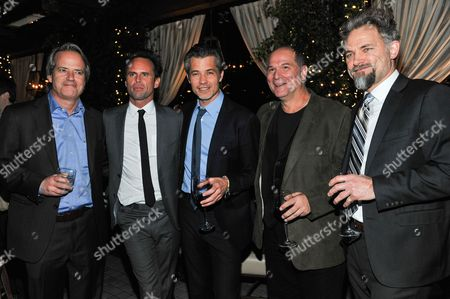 """From left, Executive producer Graham Yost, Walton Goggins, Timothy Olyphant, John Kapelos and David Meunier attend the after party for the LA Premiere Screening of """"Justifiedâ?? at RivaBella on in West Hollywood, Calif"""