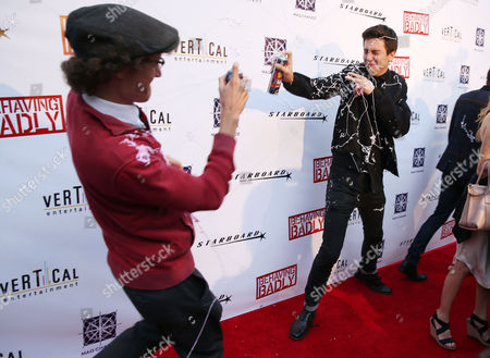 """Nat Wolff, right, and Nate Hartley spray silly string on the red carpet for a special screening of """"Behaving Badly"""" on in Los Angeles"""