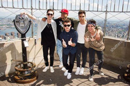 Midnight Red band members, from left, Eric Secharia, Joey Diggs Jr., Colton Rudloff, Thomas Augusto and Anthony Ladao visit the Empire State Building on in New York