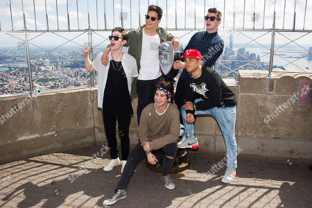 Midnight Red band members, clockwise from left, Eric Secharia, Thomas Augusto, Colton Rudloff, Joey Diggs Jr. and Anthony Ladao visit the Empire State Building on in New York