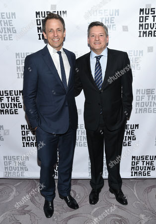 Ashton Kutcher Honorees, talk show host Seth Meyers, left, and Netflix chief content officer Ted Sarandos pose with Museum of the Moving Image executive director Carl Goodman, center, at the Museum of the Moving Image's 2016 Industry Tribute at the St. Regis Hotel, in New York