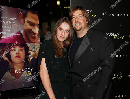 "Producers Alicia Van Couvering and producer Jonathan Schwartz arrive at the premiere of ""Nobody Walks"", in Los Angeles"