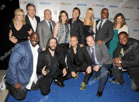 """The cast of '30 Rock' back row, from left, Jane Krakowski, Alec Baldwin, Lorne Michaels, Tina Fey, Jack McBrayer, Katrina Bowden,Keith Powell and front row, from left, Kevin Brown, Judah Friedlander, Scott Adsit, John Lutz and Grizz Chapman attend the Nokia """"30 Rock"""" wrap party on in New York"""