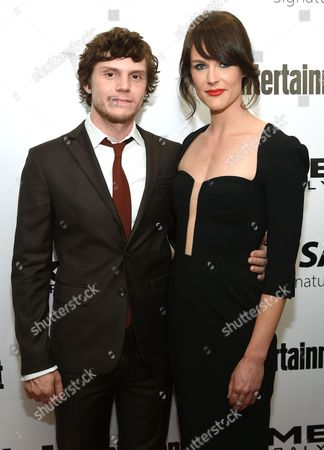 """Evan Peters, left, and Carolina Bartczak attend a special screening of """"X-Men: Apocalypse"""" at Time Inc., in New York"""