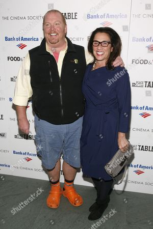 """Restauranteur Mario Batali, left, and Susi Cahn, right, attend a screening of """"A Place at the Table"""" presented by Bank of America and The Cinema Society, at the Museum of Modern Art in New York"""