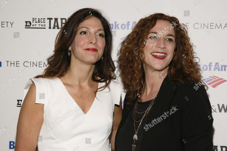 """Directors Lori Silverbush, left, and Kristi Jacobson, right, attend a screening of """"A Place at the Table"""" presented by Bank of America and The Cinema Society, at the Museum of Modern Art in New York"""
