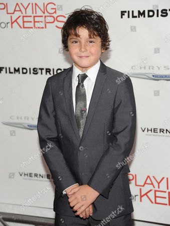 """Actor Noah Lomax attends the premiere of """"Playing For Keeps"""" hosted by the Cinema Society, Film District and Chrysler at AMC Loews Lincoln Square on in New York"""