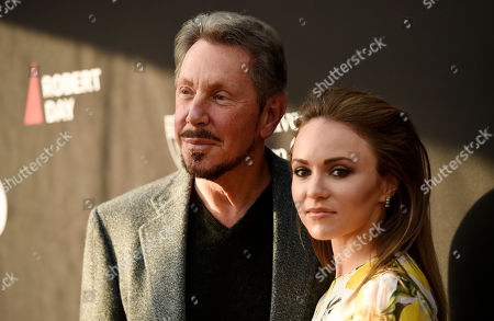 Oracle founder Larry Ellison, left, and his girlfriend Nikita Kahn pose together at the Rebels With A Cause Gala at The Barker Hangar, in Santa Monica, Calif
