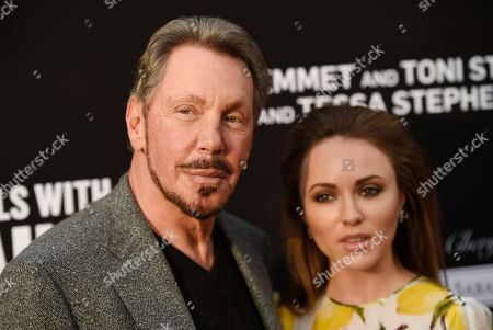 Stock Picture of Oracle founder Larry Ellison, left, and his girlfriend Nikita Kahn pose together at the Rebels With A Cause Gala at The Barker Hangar, in Santa Monica, Calif
