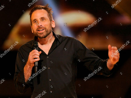 """Stock Photo of Ken Levine, creative director and co-founder of Irrational Games, presents the world premiere of """"Bioshock"""" on stage at Spike's 10th Annual Video Game Awards at Sony Studios, in Culver City, Calif"""