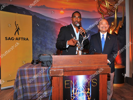 Jason George, left, and Clyde Kusatsu seen at the Television Academy's 66th Emmy Awards Dynamic and Diverse Nominee Reception at the Television Academy, in the NoHo Arts District in Los Angeles