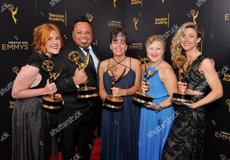 "Jennifer Serio, from left, Joe Whitmeyer, Bettie O. Rogers, Inga Thrasher, and Cara Hannah Sullivan pose for a portrait with the award for outstanding hairstyling for a multi-camera series or special for ""Saturday Night Live"" during night two of the Television Academy's 2016 Creative Arts Emmy Awards at the Microsoft Theater on in Los Angeles"